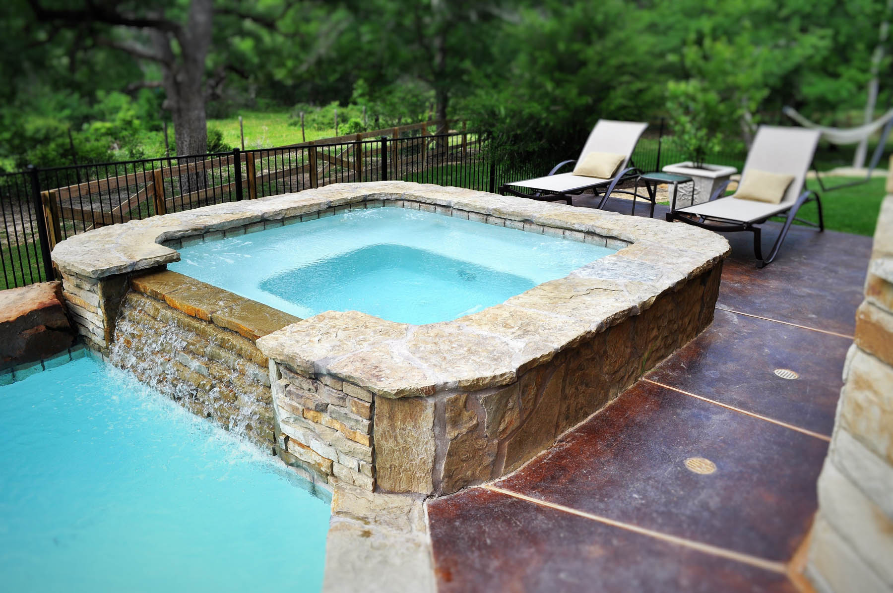 Custom Flagstone Spa With Rock Spillover